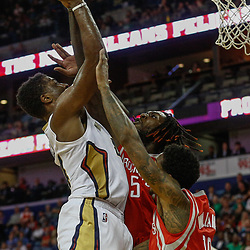 Mar 17, 2017; New Orleans, LA, USA; New Orleans Pelicans forward Solomon Hill (44) shoots over Houston Rockets forward Montrezl Harrell (5) and guard Lou Williams (12)  during the second half of a game at the Smoothie King Center. The Pelicans defeated the Rockets 128-112.  Mandatory Credit: Derick E. Hingle-USA TODAY Sports