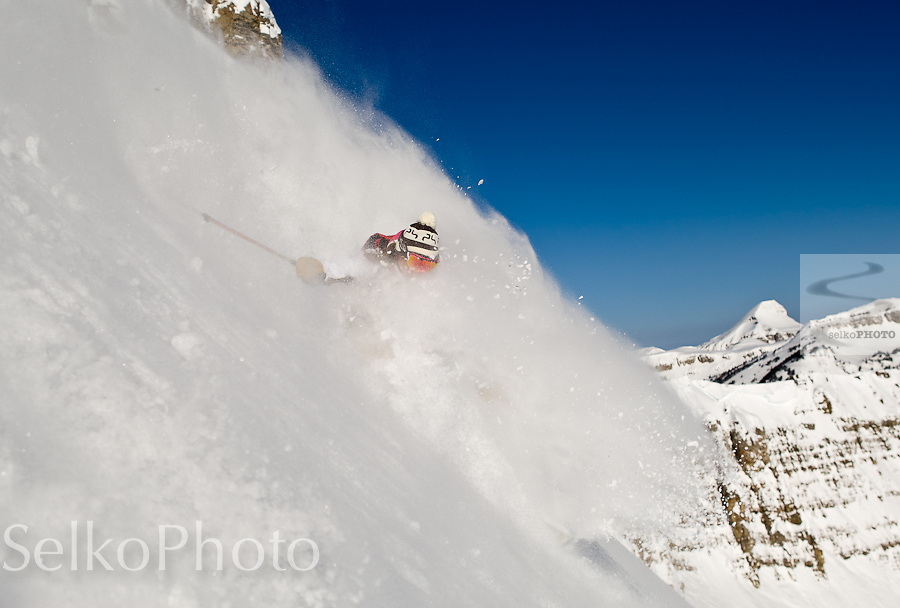 Jessica Baker skiing out of bounds from the Jackson Hole Mountain Resort, in the Bridger Teton National Forest and Grand Teton National Park on a blue sky powder day, February 27, 2011.