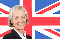 Portrait of smiling senior businesswoman over British flag