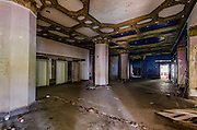 ABANDONED - THE THOMAS JEFFERSON HOTEL<br /> <br /> The Thomas Jefferson Hotel is a 19-story building, formerly a 300-room hotel, completed in 1929 at 1631 2nd Avenue North on the western side of downtown Birmingham.<br /> The hotel featured an ornate marble lobby, a large ballroom, and a rooftop mooring mast intended for use by dirigibles. The ground floor incorporated space for six shops and the basement included a billiard room and barber shop. The ballroom and dining rooms on the second floor opened out onto roof terraces from which the main tower rose. A Corinthian colonnade in glazed white terra-cotta set off the base of the tower, with the hotel entrance marked by a metal canopy. The fourth floor created an entablature, punctuated by the rhythm of windows that continued in brick for 13 more floors. The tower was capped on the top two floors with ornamented terra-cotta, including a balustrade and arched deep-set openings. The corners of the tower were clad in white brick to provide visual supports for the upper portion of the tower, while the narrow strips of brick between the windows were tan in color, each capped with a white acanthus leaf at the top. The edge of each corner was softened with a twisted-rope moulding, rising to a sculpted satyr at the top. The cornice rests on tightly spaced brackets with a shallow overhang of red mission tile suggesting a sloped roof.<br /> All rooms were air conditioned and provided with a private bath, radio, television and Muzak. The hotel operated a laundry and valet service and housed a coffee shop, lounge, pharmacy and barber shop. Nightly dinner dances were held in the Windsor Room. Other rooms available for events included the Terrace Ballroom, Jefferson Room, Green Room, Gold Room, Board Room and Director's Room.<br /> In 1933, there was a $35,000 improvement project which removed the retail spaces and merged the empty space with the hotel, creating a larger hotel lobby with an electric fireplace. The dining room was expanded and a ballroom wa