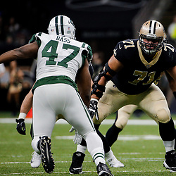 Dec 17, 2017; New Orleans, LA, USA; New Orleans Saints offensive tackle Ryan Ramczyk (71) blocks New York Jets outside linebacker David Bass (47) during the second quarter at the Mercedes-Benz Superdome. Mandatory Credit: Derick E. Hingle-USA TODAY Sports