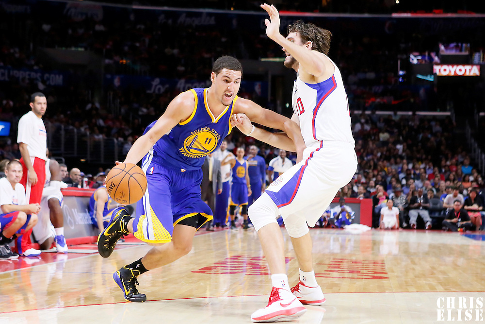 07 October 2014: Golden State Warriors guard Klay Thompson (11) drives past Los Angeles Clippers forward Spencer Hawes (10) during the Golden State Warriors 112-94 victory over the Los Angeles Clipper, in preseason opener, at the Staples Center, Los Angeles, California, USA.