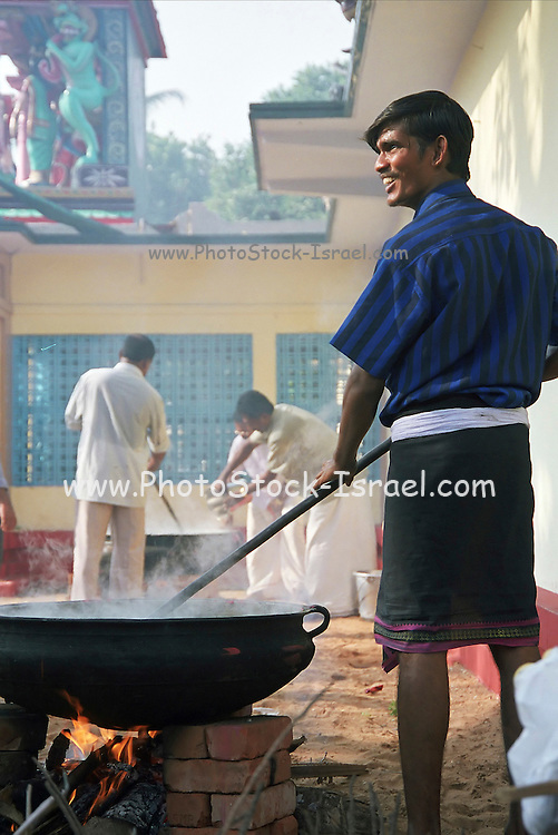 a men preparing food at a stall in the market, India, Kerala, a state on the tropical coast of south west India
