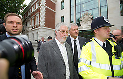 © London News Pictures. 03/10/2013 . London, UK.   Radio DJ DAVE LEE TRAVIS (centre) leaving Westminster Magistrates court in London where he faced charges of two counts of indecent assault on a woman aged over 16 between 1992 and 1993. Travis has already appeared in court to face the original 12 charges, which include indecent assault and sexual assault. Photo credit : Ben Cawthra/LNP