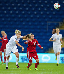 CARDIFF, WALES - Tuesday, August 21, 2014: Wales' Natasha Harding and England's captain Steph Houghton during the FIFA Women's World Cup Canada 2015 Qualifying Group 6 match at the Cardiff City Stadium. (Pic by David Rawcliffe/Propaganda)