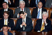 """Rep. PAUL RYAN (R-WI) looks on as President Barack Obama addresses a Joint Session of Congress Thursday night proposing a $447 billion jobs package composed of tax cuts, aid to states and infrastructure spending. The President challenged Congress to shut down the """"political circus"""" and pass what he called the American Jobs Act as soon as possible."""