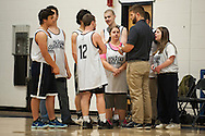 Mount Mansfield head coach Joe O'Brien talks to the team during the unified basketball game between Colchester and Mount Mansfield at MMU High School on Monday afternoon April 25, 2016 in Jericho. (BRIAN JENKINS/for the FREE PRESS)