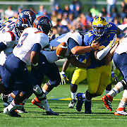Delaware Defensive tackle Zach Kerr (94) attempts to tackle Bucknell running back Jeremiah Young (3) in the back field during a Week 3 NCAA football game against Bucknell University...#13 Delaware defeated The Bison of Bucknell 19 - 3 at Delaware Stadium Saturday Sept. 15, 2012 in Newark Delaware.