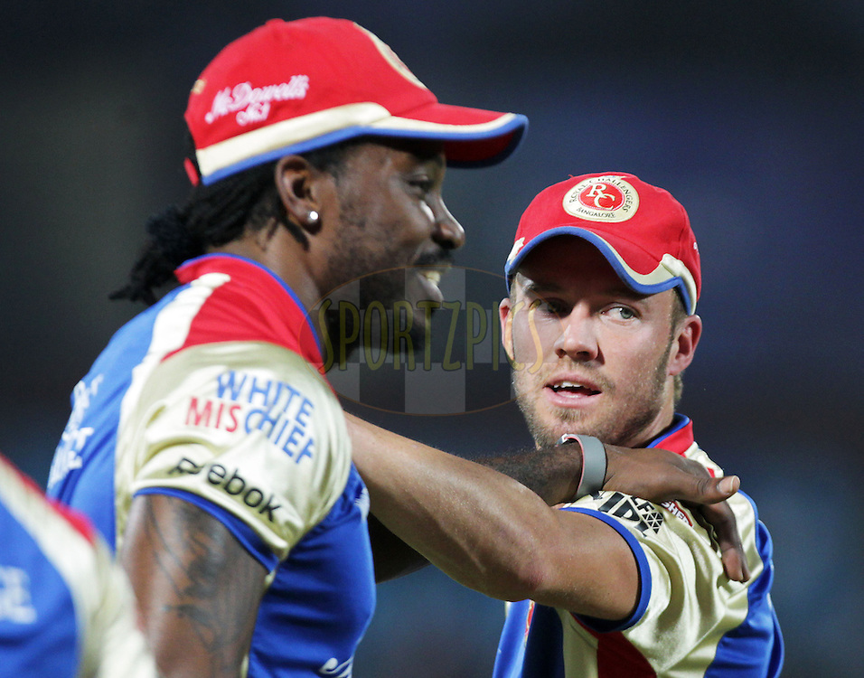 Royal Challengers Banglore player Chris Gayle and Royal Challengers Banglore player AB De Villiers during the practise of match 55 of the Indian Premier League ( IPL ) Season 4 between the Rajasthan Royals and the Royal Challengers Bangalore held at the Sawai Mansingh Stadium, Jaipur, Rajasthan, India on the 11th May 2011..Photo by BCCI/SPORTZPICS.
