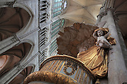 Looking up at the cloud canopy of the pulpit, carved in wood then painted and gilded in 1773, designed by Pierre-Joseph Christophle, 1715-1782, with cherubs lifting the drapery, on the north side of the nave in the Basilique Cathedrale Notre-Dame d'Amiens or Cathedral Basilica of Our Lady of Amiens, built 1220-70 in Gothic style, Amiens, Picardy, France. Amiens Cathedral was listed as a UNESCO World Heritage Site in 1981. Picture by Manuel Cohen