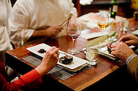 "11 December, 2008. New York, NY. Customers of a special seating enjoy a self-cooked kobe beef on hot stone in the open kitchen of Waldy Malouf at the Beacon restaurant. NOTE: the cook in the background is not Wandy. Waldy Malouf is ""on stage"" for a small birthday party of six people in the open kitchen of Beacon's dining room, a New York restaurant. Several restaurants offer special seatings with their celebrity chefs.<br /> <br /> ©2008 Gianni Cipriano for The New York Times<br /> cell. +1 646 465 2168 (USA)<br /> cell. +1 328 567 7923 (Italy)<br /> gianni@giannicipriano.com<br /> www.giannicipriano.com"