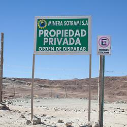 "The sign reads: Minera Sotrami S.A. P""rivate Property, order to shoot"""