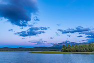 The colours of the evening twilight to the eastern sky at Maskinonge Pond in Waterton Lakes National Park, June 21, 2016, prior to moonrise but just after sunset. Note the dark shadow of the Earth rising and the pink Belt of Venus from sunlight illuminating the upper atmosphere.