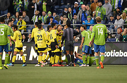 March 1, 2018 - Seattle, Washington, U.S - Soccer 2018: Players argue a foul call by referee WALTER LOPEZ as Santa Tecla FC visits the Seattle Sounders for a CONCACAF match at Century Link Field in Seattle, WA. (Credit Image: © Jeff Halstead via ZUMA Wire)