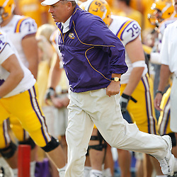 Sep 18, 2010; Baton Rouge, LA, USA;  LSU Tigers head coach Les Miles takes the field for warms ups prior to a game against the Mississippi State Bulldogs at Tiger Stadium.  Mandatory Credit: Derick E. Hingle