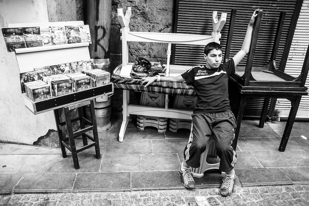 A young man selling cds and dvds in one of the streets that surround the Grand Bazaar in Istanbul.