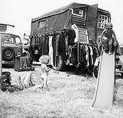 Naked hippie bohemian kids playing around, at Glastonbury, 1989.