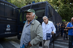 October 3, 2016 - Athens, Greece - Pensionerspass in front of riot police vans..Greek pensioners demonstrate in Athens against the goverment cuts on pensions and their benefits in General. Demonstrators clashed with riot policve after they found the road to Prime Ministers office closed by police. (Credit Image: © George Panagakis/Pacific Press via ZUMA Wire)
