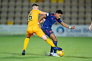 Shaun Byrne (#6) of Livingston FC tackles Demetri Mitchell (#11)  of Heart of Midlothian during the Ladbrokes Scottish Premiership match between Livingston FC and Heart of Midlothian FC at the Tony Macaroni Arena, Livingston, Scotland on 14 December 2018.