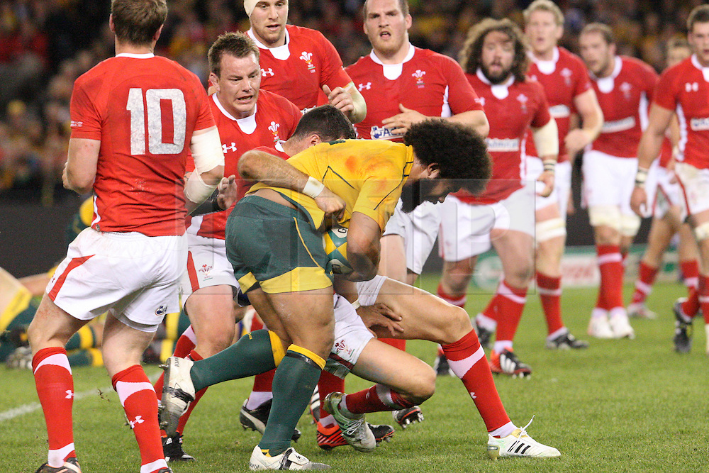 © Licensed to London News Pictures. 16/06/2012. Etihad Stadium, Melbourne Australia. Tatafu Polota-Nau gets tackled during the 2nd Rugby Test between Australia Wallabies Vs Wales . Photo credit : Asanka Brendon Ratnayake/LNP