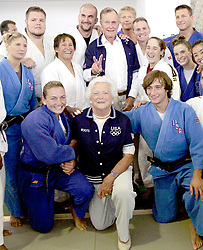 Former President George Bush plays around during a group photo with the judo team and his wife Barbara at the American College of Greece Friday August 13, 2004. Photo by Ron Cortes/Philadelphia Inquierer/KRT/ABACA.