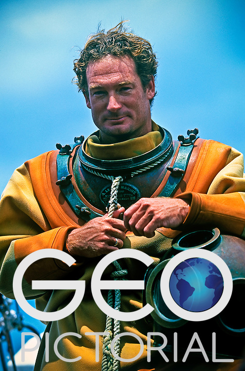 Tarpon Springs, Florida, USA; August 2003;.An exhibition sponge diver on board the St Nicholas III in traditional deep sea diving suit.