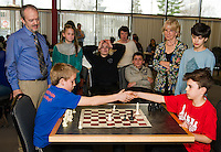 Kaden Dolloff from Elm Street School shakes hands with Finnian Mousseau of Pleasant Street School at the conclusion of their game during the City Wide Chess Tournament at Huot Technical Center on Saturday morning.  (Karen Bobotas/for the Laconia Daily Sun)