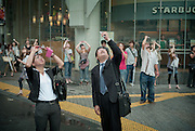 Shibuya, Tokyo, Japan - 22nd of July 2009 - Japanese people taking pictures of the partial solar eclipse (75%) with their mobile phone.