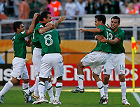 Photo: Glyn Thomas.<br />Mexico v Iran. Group D, FIFA World Cup 2006. 11/06/2006.<br /> Mexico's Omar Bravo (second from R) is mobbed by teammates after scoring his team's second goal.