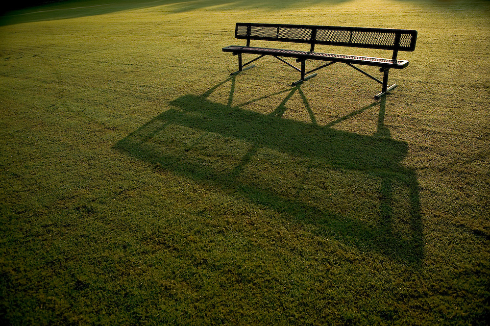 Park bench on a playing field