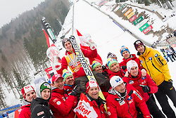 Overall World Cup winner Gregor Schlierenzauer of Austria celebrates with his team after the trophy ceremony after the Flying Hill Individual Event at 4th day of FIS Ski Jumping World Cup Finals Planica 2013, on March 24, 2013, in Planica, Slovenia. (Photo by Vid Ponikvar / Sportida.com)