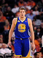 Feb. 22, 2012; Phoenix, AZ, USA;  Golden State Warriors forward David Lee (10) reacts on the court against the Phoenix Suns at the US Airways Center.  The Warriors defeated the Suns 106 - 104. Mandatory Credit: Jennifer Stewart-US PRESSWIRE.