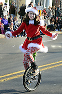 Isabella Carcaci of Newtown, Pennsylvania rides a unicycle during the Newtown Holiday Parade Sunday December 6, 2015 in Newtown, Pennsylvania. (Photo by William Thomas Cain)