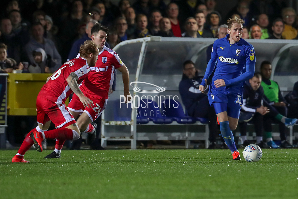 AFC Wimbledon midfielder Mitchell (Mitch) Pinnock (11) dribbling away from Gillingham attacker (Tom) Thomas O Connor (24) during the EFL Sky Bet League 1 match between AFC Wimbledon and Gillingham at the Cherry Red Records Stadium, Kingston, England on 23 November 2019.