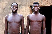Benin, Natitingou April 22, 2005 - A father and his son with same scarifications on their bodies. These scarifications represent the passage at the adulthood