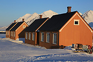 "So-called ""London Houses"" (moved intact from a British mine across the fjord) are part of the international science village of Ny-Alesund on Spitsbergen island in Kongsfjorden; Svalbard, Norway."