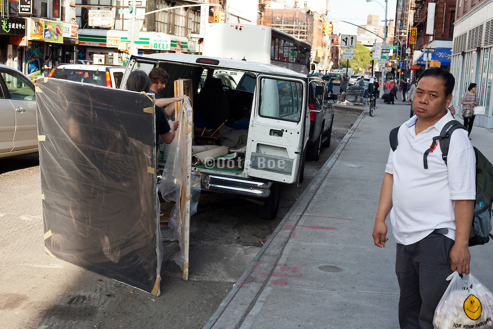 paintings being transported on the Lower Eastside in New York City
