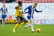 David Perkins of Wigan Athletic and Larnell Cole of Shrewsbury Town during the Sky Bet League 1 match at the DW Stadium, Wigan<br /> Picture by Matt Wilkinson/Focus Images Ltd 07814 960751<br /> 21/11/2015