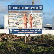 A board posted by the city of Haria at the entrance of Charco del Palo reminds people that this is a nudist place and the it should be respected.