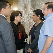 FORT LAUDERDALE, FLORIDA, DECEMBER 21, 2015<br /> Suspended Broward Sheriff's deputy Peter Peraza and his family, from left; wife Melinda and parents Gilbert and Elizabeth Peraza and  outside of a courtroom in the Broward County Courthouse following a brief court appearance. Peraza faces manslaughter charges in the shooting death of Jermaine McBean, 33, in July of 2013.<br /> (Photo by Angel Valentin/Freelance).