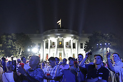 July 4, 2018 - Washington, District of Columbia, United States of America - Guests react on the South Lawn of the White House during a fireworks display in Washington, D.C., U.S., on Wednesday, July 4, 2018. Trump's campaign won the technical knockout of a lawsuit filed by two Democratic National Committee donors and a DNC staffer who accused it of colluding with Russian to publish compromising information about the Clinton campaign on WikiLeaks that included details about their lives. .Credit: Yuri Gripas / Pool via CNP (Credit Image: © Yuri Gripas/CNP via ZUMA Wire)