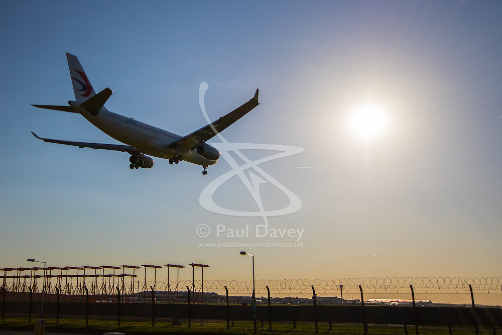 An Airbus A330 lands on runway 27R at London's Heathrow Airport (LHR / EGLL).