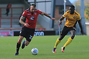 Max Muller of Morecambe takes on Frank Nouble of Newport County during the EFL Sky Bet League 2 match between Morecambe and Newport County at the Globe Arena, Morecambe, England on 16 September 2017. Photo by Mick Haynes.