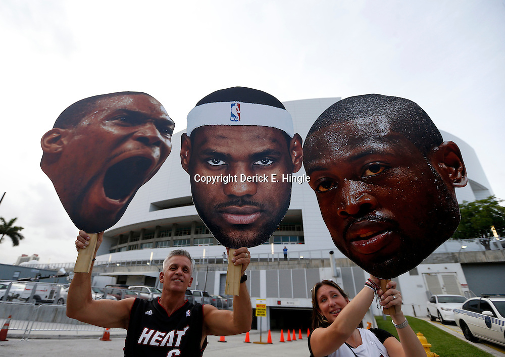 Jun 20, 2013; Miami, FL, USA;  Miami Heat fans hold posters of Miami Heat center Chris Bosh, LeBron James and Dwyane Wade prior to the start of game seven in the 2013 NBA Finals at American Airlines Arena. Mandatory Credit: Derick E. Hingle-USA TODAY Sports