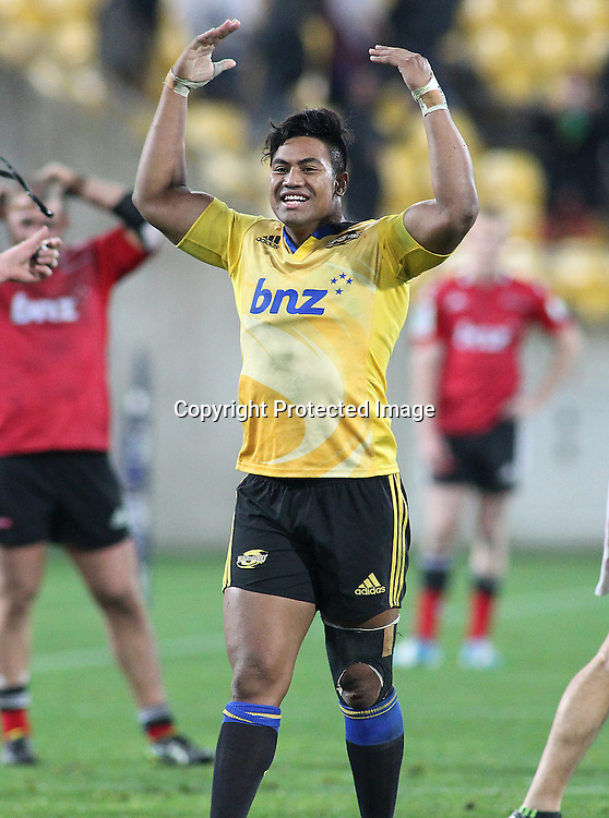 Hurricanes' Julian Savea celebrates the Hurricanes win during the Round 17 Super Rugby match, between the Hurricanes & Crusaders. Westpac Stadium, Wellington. 28 June 2014. Photo.: Grant Down / www.photosport.co.nz