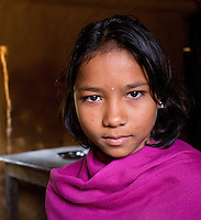 Young girl wearing a handmade pink pashmina in a Tharu village in the Terai region of Nepal