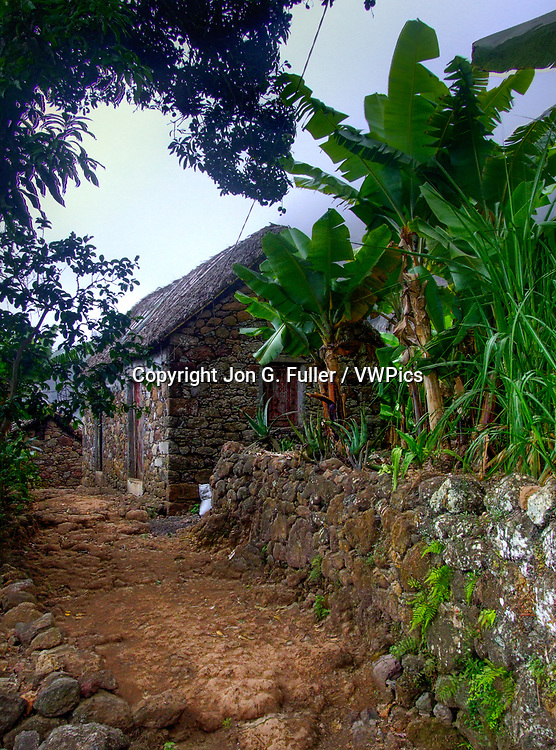 Stone farmhouse iwith a thatched roof in the Valley of Paul, Santo Antao, Republic of Cabo Verde, Africa.  Banana plants grow in the foreground.