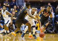 Jan 9, 2016; Morgantown, WV, USA; West Virginia Mountaineers guard Jaysean Paige (5) steals the ball during the first half against the Oklahoma State Cowboys at the WVU Coliseum. Mandatory Credit: Ben Queen-USA TODAY Sports