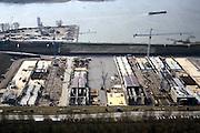 Nederland, Barendrecht, Oude Maas, 08-03-2002, in dit bouwdok worden de tunnel elementen van zowel de HSL tunnel onder de Oude Maas als de HSL tunnel onder de Dordtse Kil gebouwd; na het voltooien vd tunnel elementen wordt de dijk doorgraven waardoor het dok vol loopt en kunnen de drijvende elementen naar de respectievelijke lokaties gesleept worden. infrastructuur ruimtelijke ordening landschap.<br /> luchtfoto (toeslag), aerial photo (additional fee)<br /> foto /photo Siebe Swart