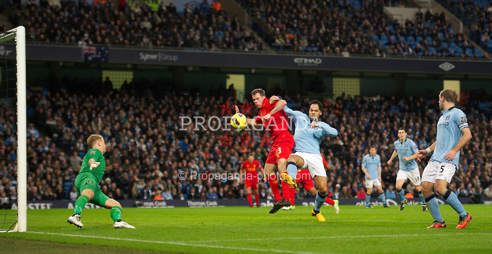 MANCHESTER, ENGLAND - Sunday, February 3, 2013: Liverpool's Jamie Carragher in action against Manchester City's Joleon Lescott during the Premiership match at the City of Manchester Stadium. (Pic by David Rawcliffe/Propaganda)